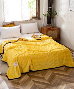 Plaid haut de gamme sur lit